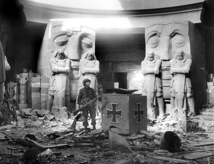 A U.S. soldier stands in the middle of rubble in the Monument of the Battle of the Nations in Leipzig after they attacked the city on April 18, 1945. The huge monument commemorating the defeat of Napoleon in 1813 was one of the last strongholds in the city to surrender. One hundred and fifty SS fanatics with ammunition and foodstuffs stored in the structure to last three months dug themselves in and were determined to hold out as long as their supplies. American First Army artillery ...