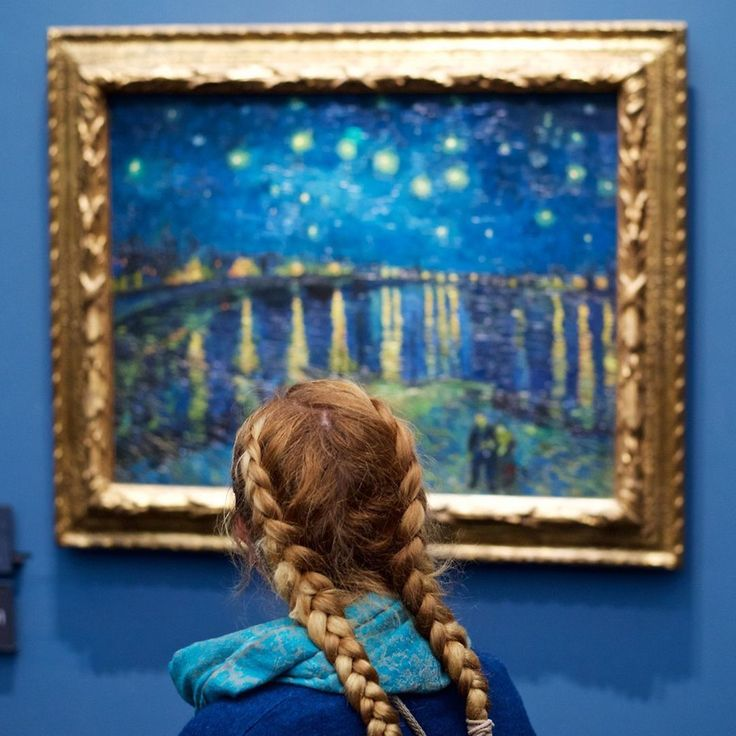 """[repost] We're in love with the art photography series by Stefan Draschan entitled """"People Matching Artworks"""" where he patiently waits for JUST THE RIGHT SPOT and MOMENT to capture shots of audiences coincidentally matching the paintings they're viewing, such as this shot of a young girl in golden braids and a blue jacket viewing Van Gogh's """"Starry Night Over The Rhone"""" (1888), also displayed and framed in the same colors! . (@stefandraschan)  . #vangogh #starrynight #art #class #golden…"""