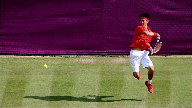 Kei Nishikori of Japan returns a shot  Kei Nishikori of Japan returns a shot to Juan Martin Del Potro of Argentina during the quarter-final of men's Singles Tennis on Day 6 of the London 2012 Olympic Games at Wimbledon.