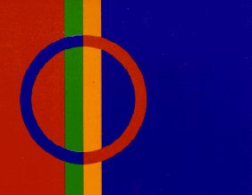 "Flag of the Sami people. It's rather new, designed and officially recognized in 1986 by the Nordic Sami Conference. Astrid Båhl from Norway designed this flag which is based on the 4 colors (red, blue, green and yellow) from the traditional Sami dress. The design of the flag was inspired by the shaman's drum and the poem ""Paiven parneh"" (""Sons of the Sun"") by the Anders Fjellner (1795-1876). In this poem Fjellner describes the Saami as sons and daughters of the sun. The flag's circle…"