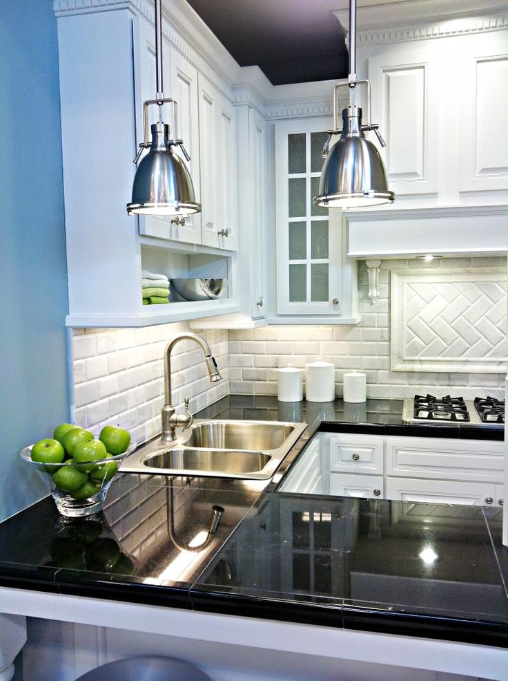 White cabinets-black countertops-marble backsplash