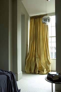 Rose Uniacke - Interiors - London Apartment W9. I love the billowing mustard coloured curtains against the dark grey in this idyllic master bedroom
