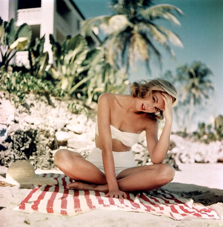 Grace Kelly. Jamaica, 1955. Photo by Howell Conant.