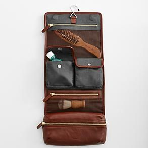 leather travel case from RedEnvelope.com The Essentials  Toothbrush and toothpaste Razor blades Razor Shaving cream Deodorant Shampoo A comb Hair product of choice The Luxuries  Moisturizer Cologne Hand lotion Aftershave Chapstick Mouthwash The Utilities  A sewing kit Fingernail clippers Pocket knife Aspirin Band-aids Styptic pencil