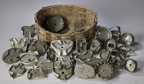 Cowan's Auctions: Basket of Figural Antique Tin Cookie Cutters lot of 31, all American and mid 19th through early 20th century. Includes 9 different birds, 6 birds in flight, 2 chickens and 1 duck; PLUS 2 men, one in profile and one front view; PLUS 1 fish; PLUS 1 lamb; PLUS 1 horse; PLUS 1 rabbit; PLUS 1 flower; AND 15 different geometric designs, various sizes.
