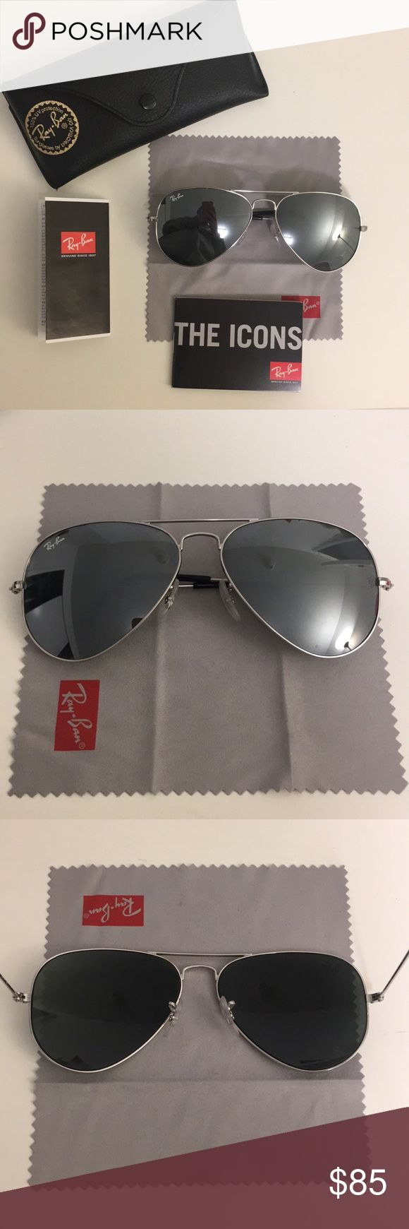 Ray-Ban Classic Aviators with silver mirror lenses Ray-Ban Classic Aviators in excellent condition, only worn twice - ZERO scratches! Silver frame with silver mirror lenses Lightweight and stylish Comes with original case, lens cleaning cloth and pamphlets 58mm. Technically unisex, but I have a smaller face and they looked great (see second pic) Inscription on left: RB 3025 AVIATOR LARGE METAL W 3277 58014 3N Inscription on right: Ray-Ban MADE IN ITALY Ray-Ban Accessories Sunglasses