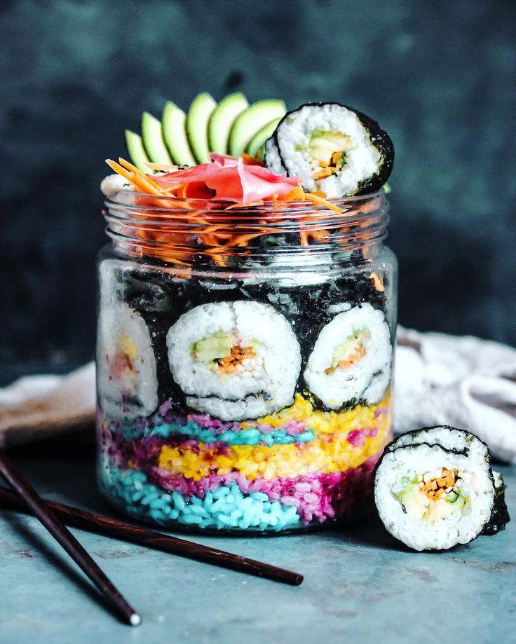 Introducing..  Sushi Salad Jar  It was inevitable this was going to happen  lol) My first entry to the #BESTOFVEGANSALADJAR competition (click that hashtag to see everyone's awesome jars!) - A base of rainbow veggie rice (Coloured with natural tones; Beetroot powder Turmeric & Blue Spirulina) - Cucumber Carrot and Avo Sushi Rolls - Kale massaged in rice vinegar and sesame oil - Shredded Carrot - An Avocado Fan - Pickled Ginger - Black Sesame (I'm meant to be doing work but here I am…