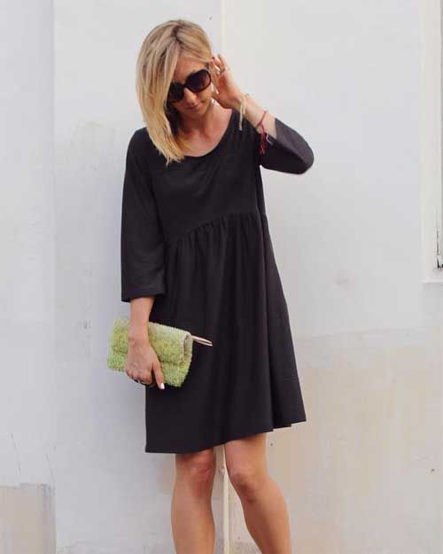 This tea length dress has light draping and a simple but comfortable bohemian style. The dress features three quarter length sleeves, pockets, light gather