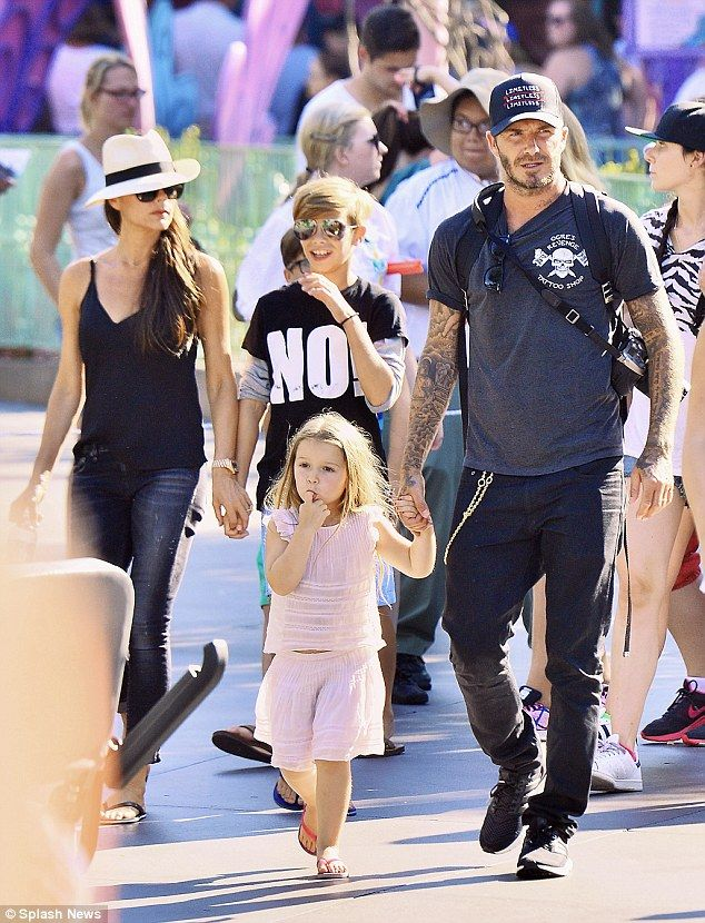 Fashion family: David and Victoria Beckham lead the fashion pack family during a day out atAnaheim, CA Disneyland last week