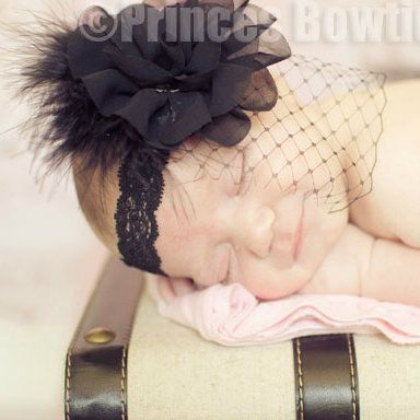 Your baby will love this black timeless vintage headband when you put this vintage baby headband on her. It comes attached black lace fancy headband. The Black Big chiffon flower is embellished with marabou, netting, and then topped off with a strand of black pearls.