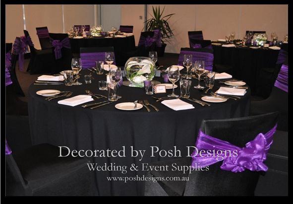 Purple sashes on black chair covers with black table cloths - www.poshdesigns.com.au