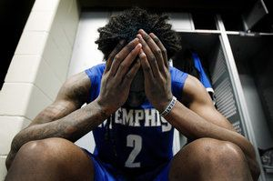 March 13, 2016 -  Dejected University of Memphis senior Shaq Goodwin tearfully buries his head into his hands while sitting in the team locker room after falling to University of Connecticut 72-58  in the AAC tournament championship game at the Amway Center in Orlando, Florida. Goodwin did not have a very productive day only scoring six points and five rebounds. (Mark Weber/The Commercial Appeal)