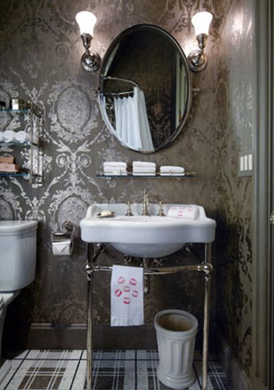Silver damask wallpaper, open sink, & oval mirror w/plaid floor