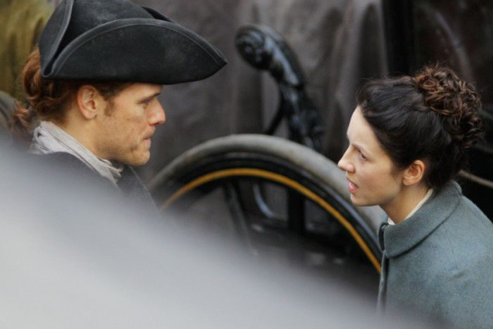 Sam Heughan and Caitriona Balfe pictured filming in Tweeddale Court. Picture: SWNS
