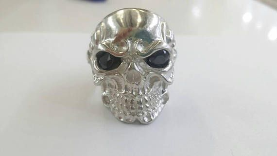Check out this item in my Etsy shop https://www.etsy.com/uk/listing/548688304/silver-skull-ring-with-blue-zirconium