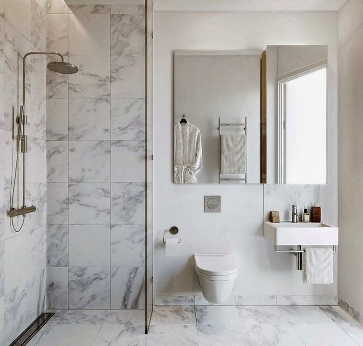 Extravagant marble bathroom. The white colours gives the room a clean and nordic look. Because of the subtle colours, you can decorate the bathroom with interior in different colours