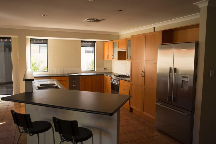 Before Photo of Southern River Kitchen. Old Ikea Kitchen.  Large space but cupboards and bench space was minimal.