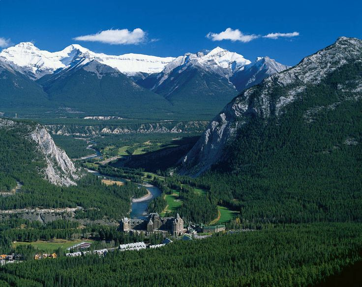 Banff Springs,Alberta.  The large castle type building is the Banff Springs Hotel  built by the Canadian Pacific Railroad for it's travellers. The river is the Bow River which flows into Calgary. This is a great ski area.