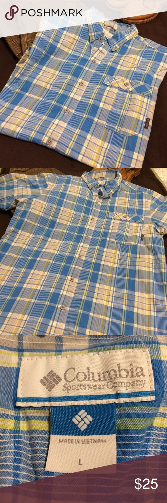 Columbia Sportswear Plaid Button Down Shirt Attractive and functional Columbia Sportswear button down short-sleeved shirt. Size Large. Great blue & white color with a bit of light orange & yellow to accent. True to Columbia Sportswear it is in great shape with a lot more wear in it. Columbia Shirts Casual Button Down Shirts