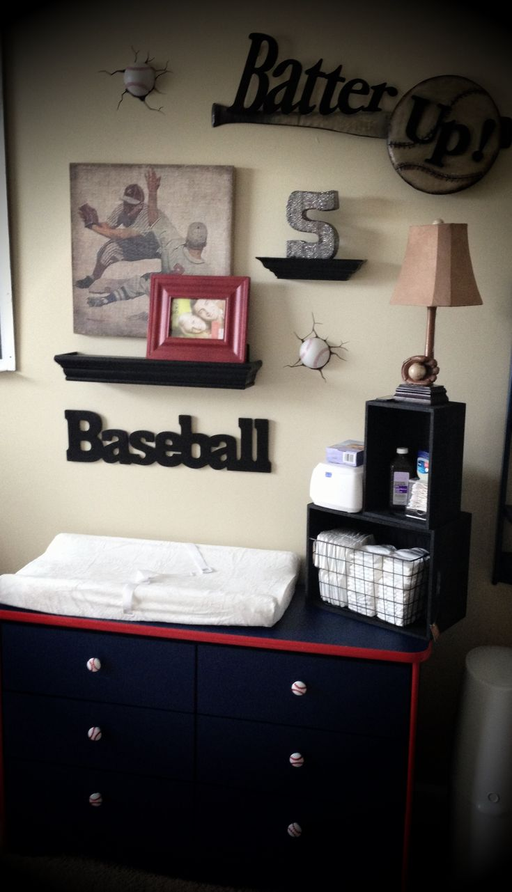 Vintage baseball decor....love the diapers in the basket, the knobs, lamp, and baseball sign.