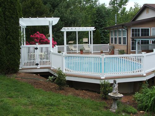 Above ground pools decks idea vinyl deck railing on your for Above ground pool vinyl decks