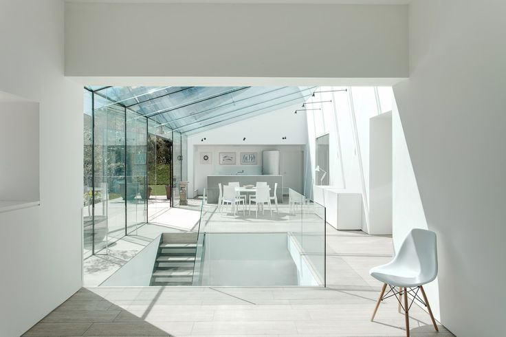 The secondary spaces of this glass enclosure provide contrasting environments, providing the occupant with a variety of living space and emphasising the openness of the main glazed living space.