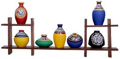 Beautifully arranged terracotta pots in a wooden shelf....