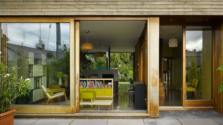 Sliding doors connect John McLaughlin's timber-framed Open House with its garden.