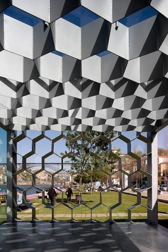 "Honeycomb structure of Ar de Rio Cafe in Vila Nova de Gaia,  ""The new space is pretty much about skin becoming structure,"" says architectural firm Guedes + DeCampos, designers of the project.  ""It had to be that gentle, not only in order to maintain a strong coherence in the set, but also to correspond to the breathtaking landscape."""