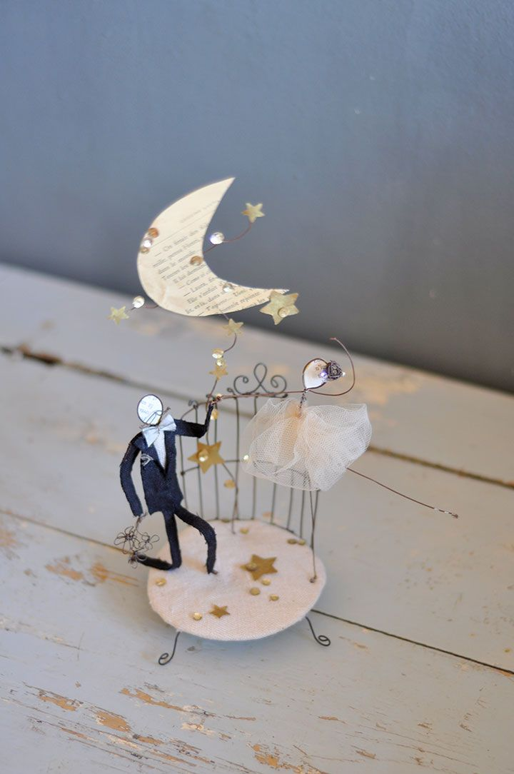 Sweet wedding topper.  Love the moon and stars.