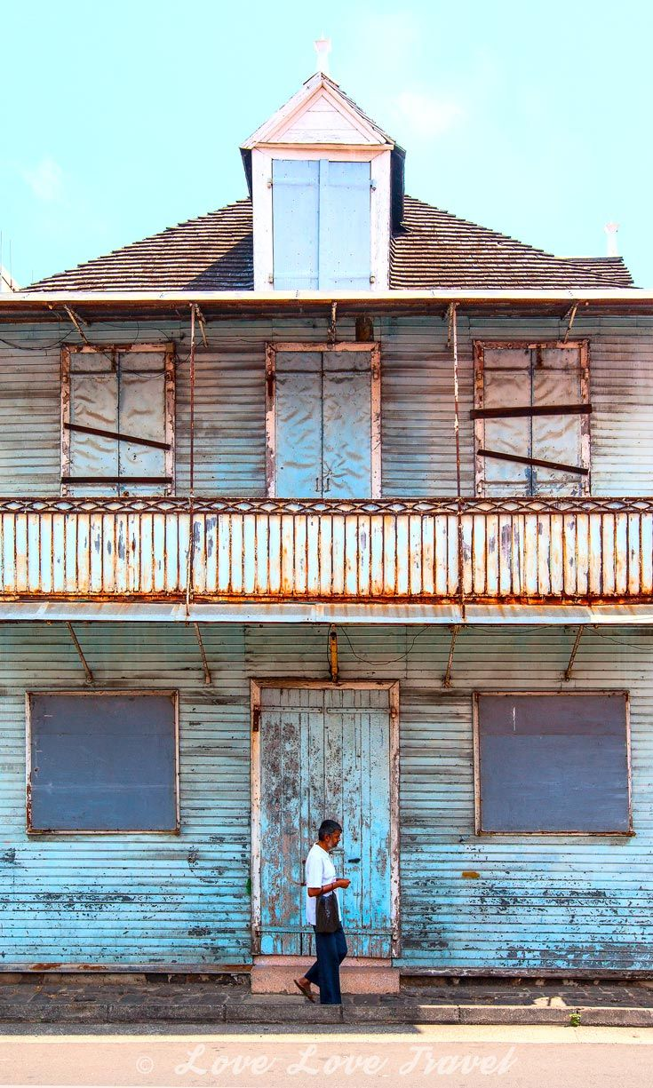 Port Louis, Mauritius: While new office blocks dominate the central business district you will find that Port Louis still has many old, textured shop houses. In the past the ground floor would be for business while the family lived upstairs.