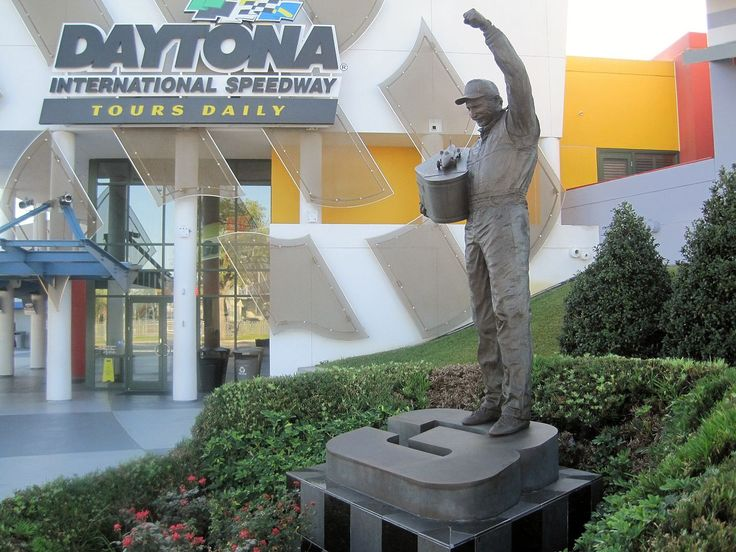 Statue of Dale Earnhardt Sr. holding his winner's trophy at the Daytona International Speedway