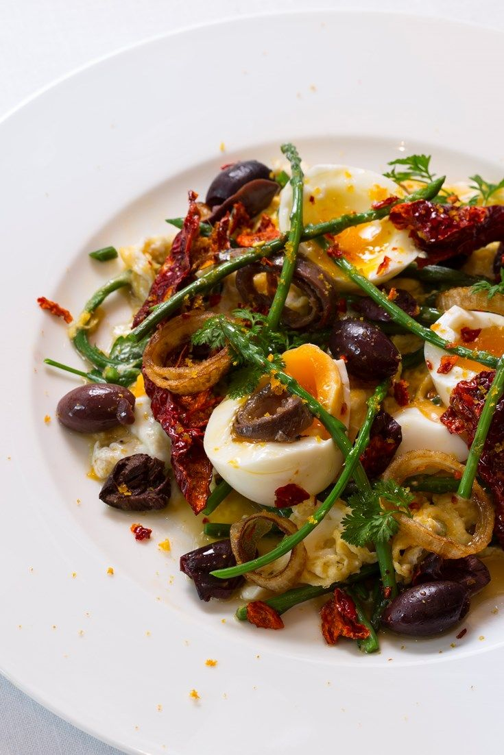 Francesco Mazzei's warm egg salad recipe could be treated as a light lunch dish or savoury brunch, with both scrambled and soft-boiled eggs featuring alongside a plethora of Mediterranean ingredients – black olives, anchovies, and spicy dried red chillies.