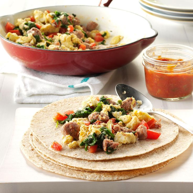 Sausage-Egg Burritos Recipe -My husband and I try to eat healthy, but finding new meals for breakfast is a challenge. By adding tomatoes, spinach and garlic to traditional egg whites, we can have a dish that is both light and satisfying.—Wendy G. Ball, Battle Creek, Michigan.