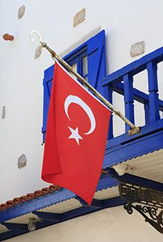 TURKEY: FLAG DAY Friends of the groom plant the Turkish flag, which features a red crescent and star, in the ground at his home on the day he is to wed. Depending on the area, objects like fruit, vegetables and even mirrors are placed on top, signifying the wedding ceremony has begun.  45 Fascinating Wedding Traditions from Around the World