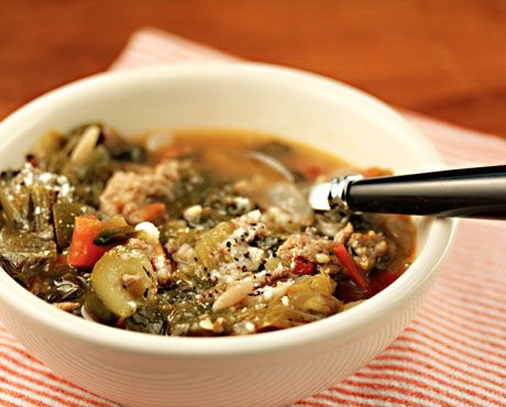 Turkey escarole soup enriched with a parmesan cheese rind, from The Perfect Pantry.