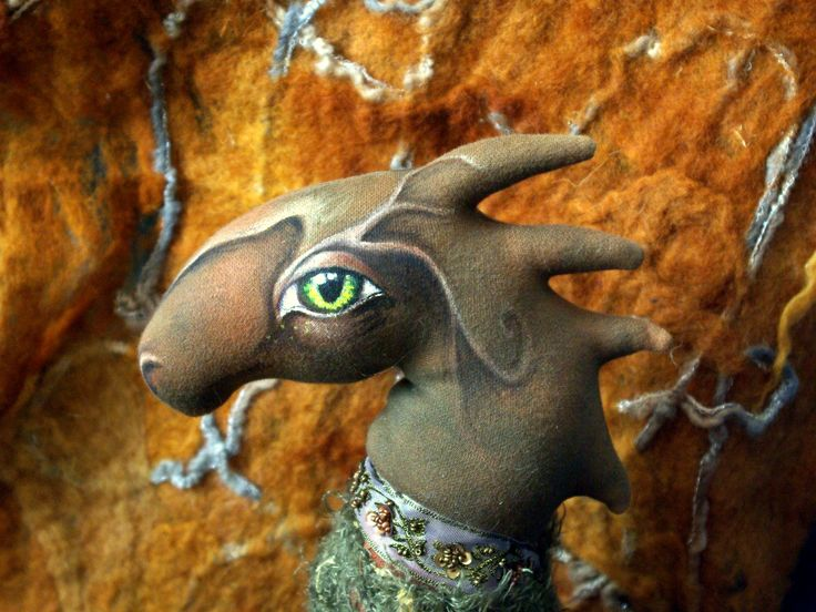 Dragon born of forest moss and of shadows in  furrows in the bark of trees. Big 50 cm. Crafted from cotton and wool. He has  frame from wire. Hand-sewn and hand-painted. Price 1880 CZK.
