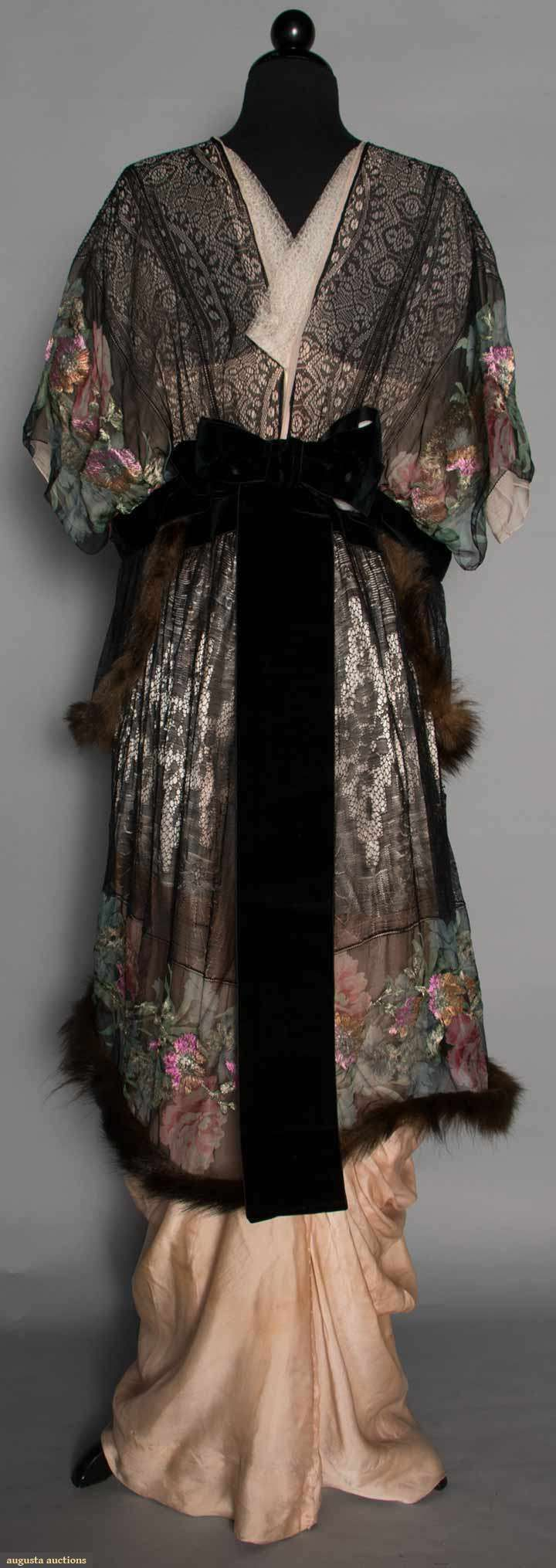 PRINTED LAME EVENING GOWN, c. 1913. Gown of floral printed & lame brocaded chiffon w/ black lace, short kimono sleeves, 2 fur trimmed chiffon & lace skirt tiers, black velvet bow trims, narrow draped pale pink underskirt. Back
