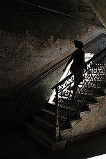 Woman walking up stairs stairway historic centre Havana Ciudad de La Habana Cuba - stock image