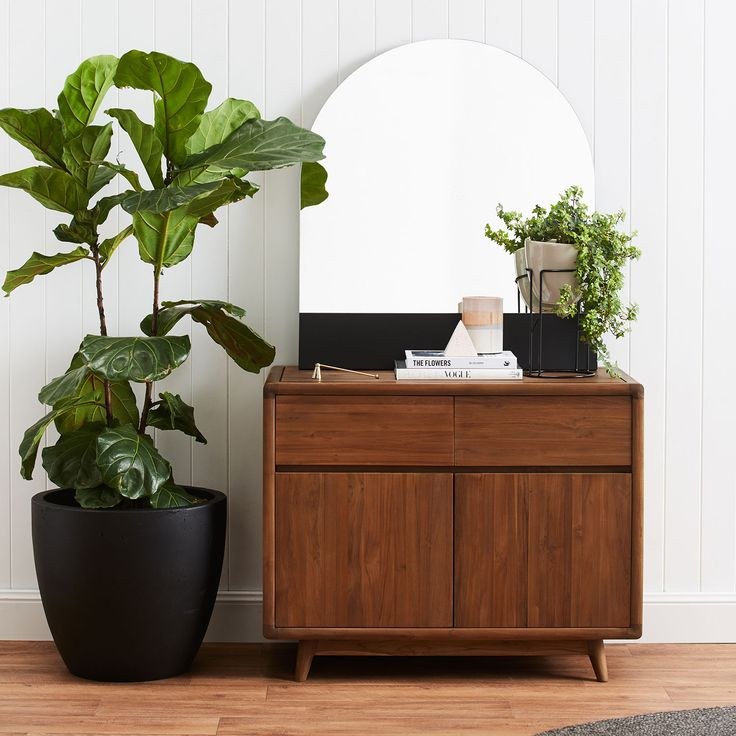 Plants & Black Accents: Introducing our brand new Vintage Compact Sideboard in Teak by Karpenter ideal stylish storage for a smaller room. Lean a mirror or a print, add a pot or lamp and stack your best books for some easy sideboard styling...