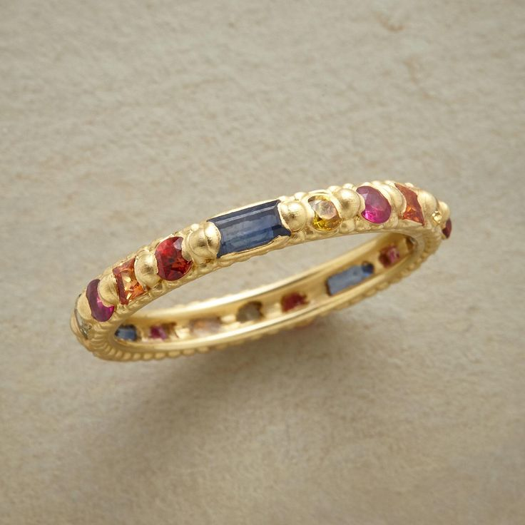 SAPPHIRE ANTHOLOGY RING--Artist Polly Wales handcrafts an anthology of multi-color sapphire. Round, princess and baguette cut gems are set in an 18kt gold ring brushed to a soft finish. Whole sizes 5 to 9.