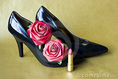 Black high heel shoes, paper roses and a lipstick