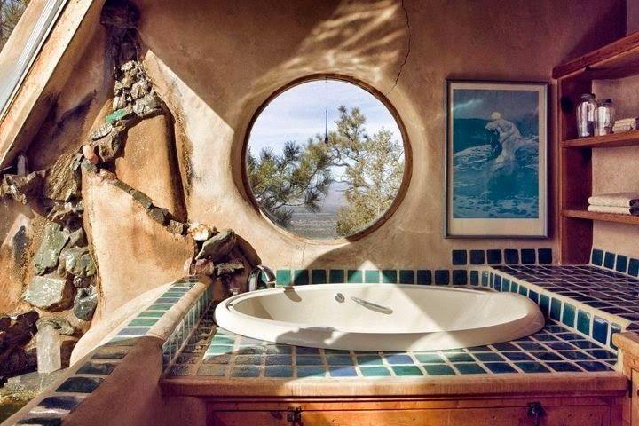 A cob bathroom built for those who enjoy the soak.