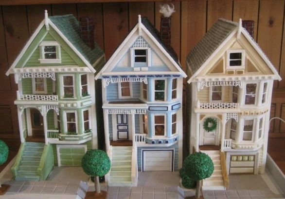 This row of gingerbread houses weighs about 80 pounds, measures 28 inches by 18 inches by 18 inches, and took a more than two months to build. The houses feature shiplap and individual pastillage shingles. The windows are gelatin sheets, and the inside figures are made of marzipan. The trees are fondant rolled in granola, then covered in royal icing. Created by Russ R. of Orinda, CA. See more details of this Victorian trio.