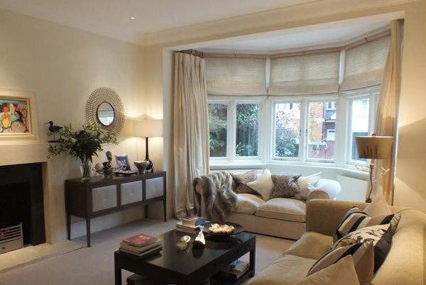 #beige living room with #dress #curtains - design by Sarah Assael, expert member of The DecorCafe Network