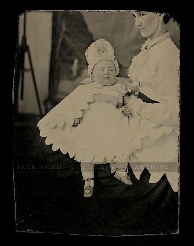 http://www.ebay.com/itm/hidden-mother-with-post-mortem-baby-in-white-1860s-tintype-photo-/162572504867?hash=item25da138f23:g:V70AAOSwBt5ZLthL