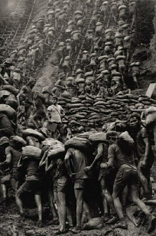 This is where gold comes from. Slave labor and poisoned water. Sebastiao Ribero Salgado 1986. The gold mine of Serra Pelada Brazil.