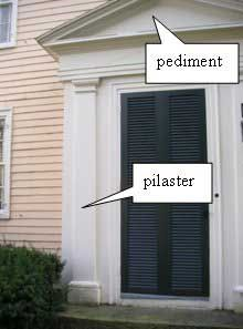 A pilaster is a flat, engaged column with a base and capital; pilasters frequently flank entrances as part of the surround (Figure G). Description from preservation.mhl.org. I searched for this on bing.com/images
