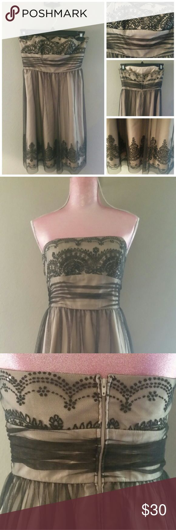 DAVID'S BRIDAL BLACK SEQUIN DRESS SIZE 6 DAVID'S BRIDAL BLACK/CREAM SEQUIN DRESS, SIZE 6, 100% POLEYESTER, SLEEVLESS, LENGTH 34 INCHES David's Bridal Dresses Prom