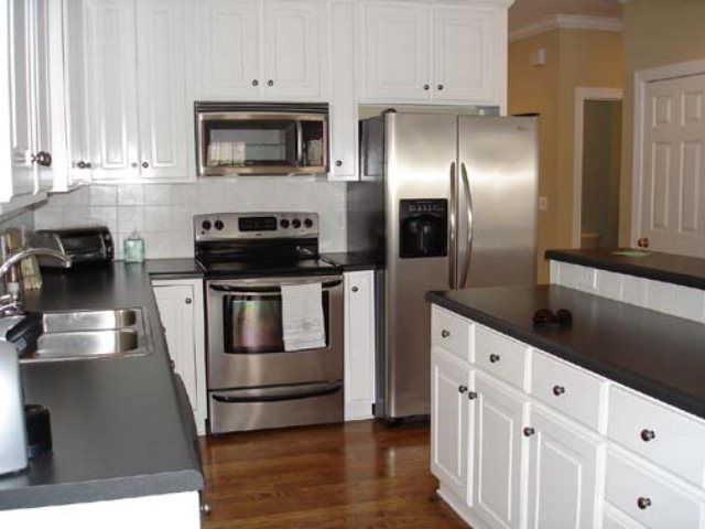 mesmerizing kitchen cabinet colo | Black and white kitchen with stainless steel appliances ...